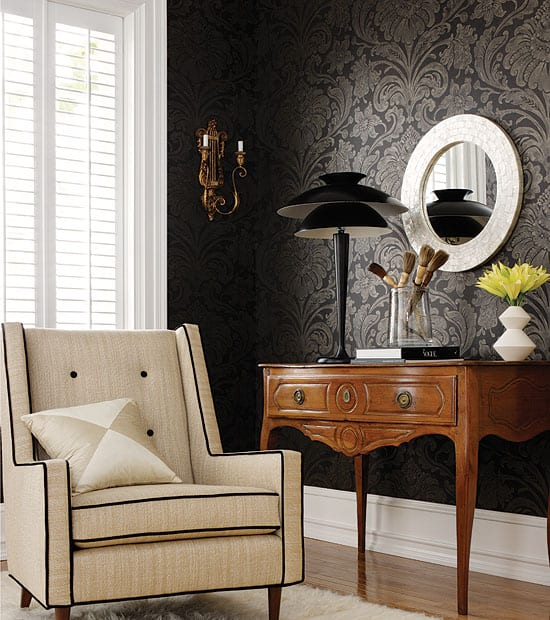 A living room wallpaper featuring a black and cream-white combination with a pattern that compliments the upholstery in the same room