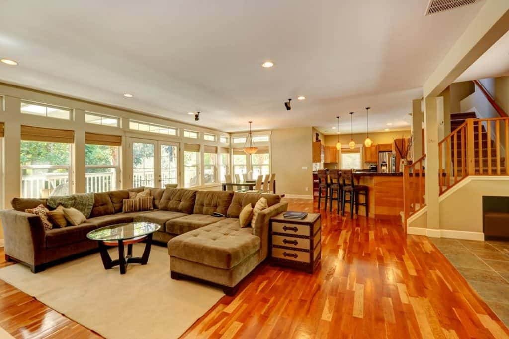 Traditional modern living room with cozy couch, throw pillows and glass coffee table