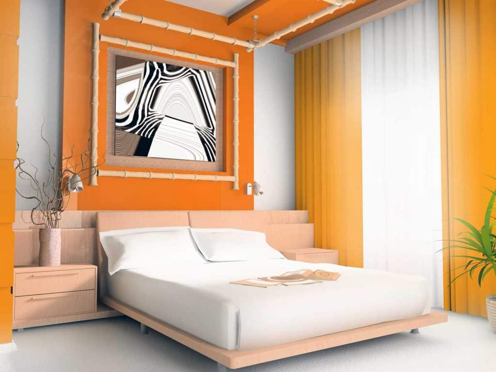 Orange colored bedroom with small indoor plants on the side and a floor length curtain