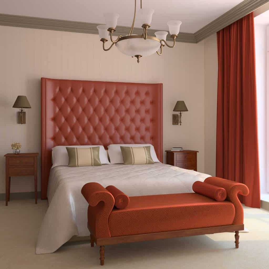 A red themed bedroom with a huge red header wall, white beddings, and a red floor length curtain