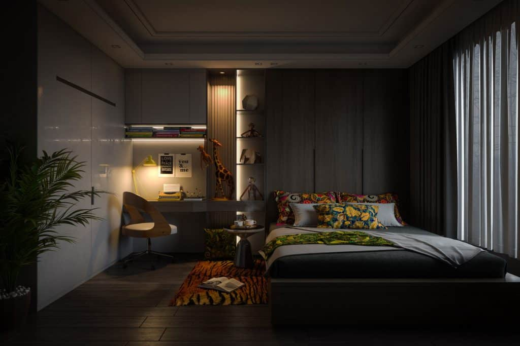 A cozy and warm bedroom with dark flooring, dark gray curtains, and a warm floral bed