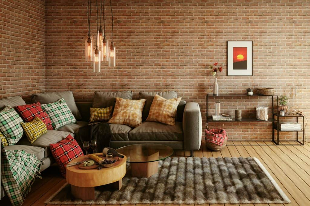 A gorgeous brown themed living room with throw pillows placed one side for proper placement