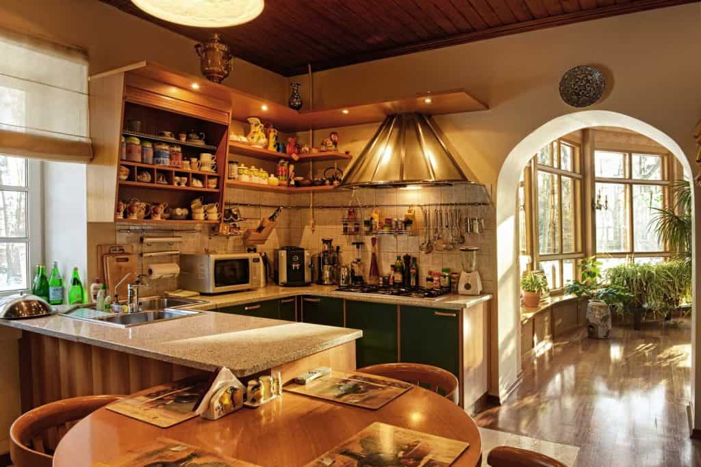 A compact well-lit farmhouse kitchen in a country home