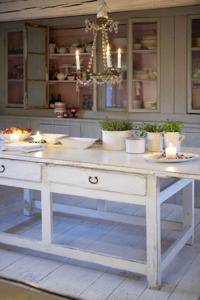 Antique kitchen table in old primitive-style kitchen