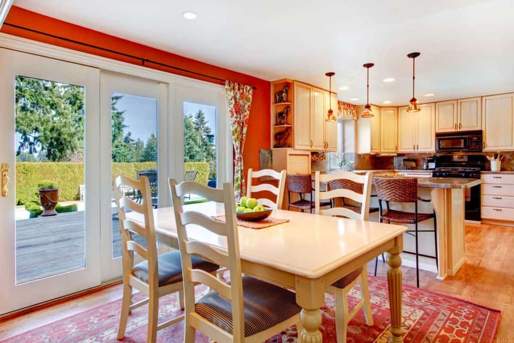 Bright rustic style kitchen with overlooking dining area