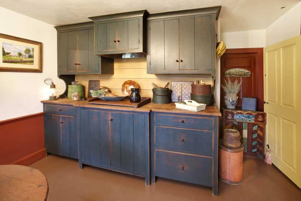 Colonial style farmhouse kitchen in washed blues and greens