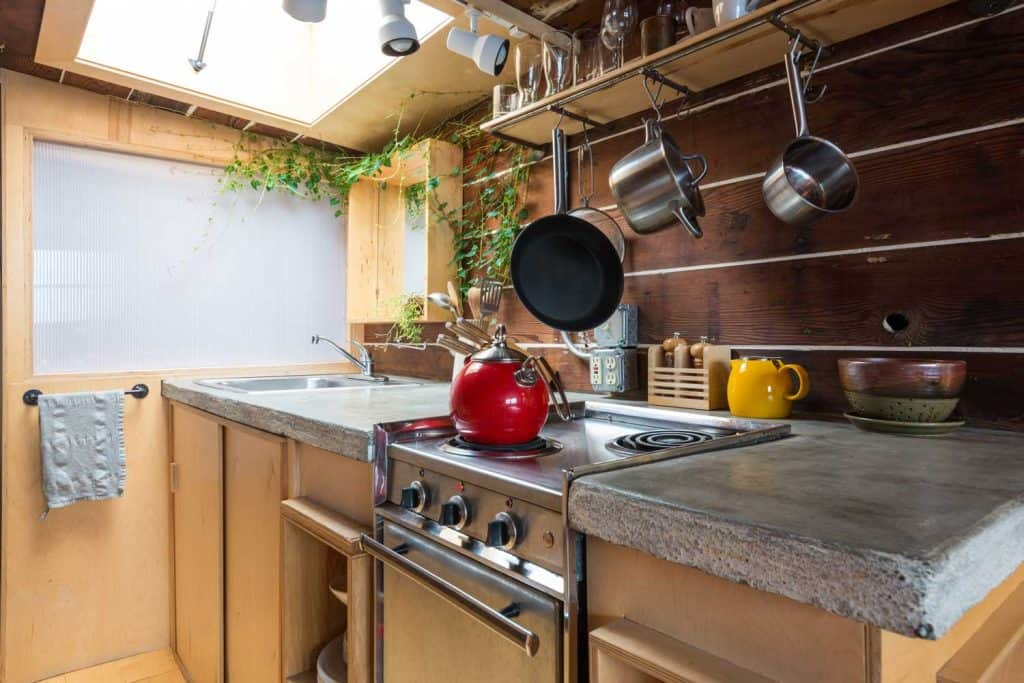 Compact rustic kitchen with gorgeous stone block countertops