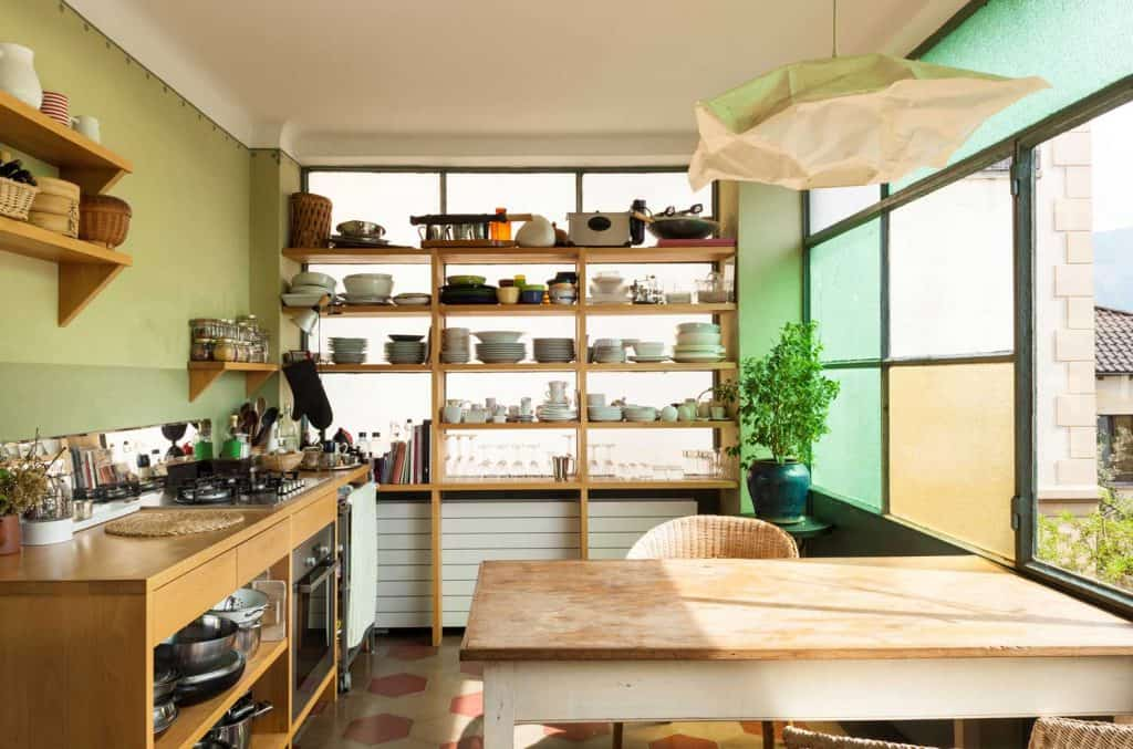 Contemporary loft rustic kitchen with an overlooking window