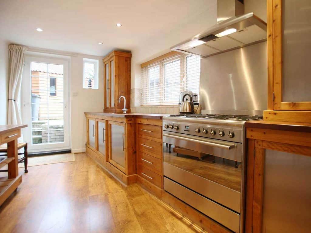 Country-style kitchen complemented with an oak floor
