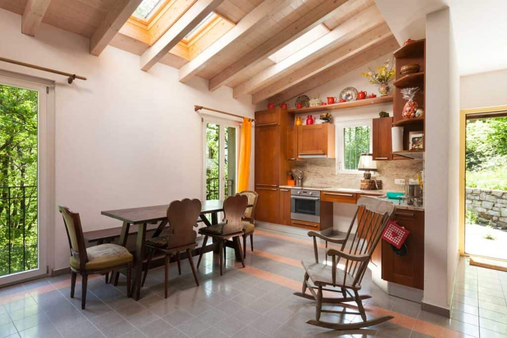 Domestic rustic kitchen with primitive wooden chairs