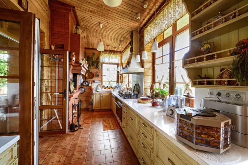 Large high-ceiling kitchen in a country house