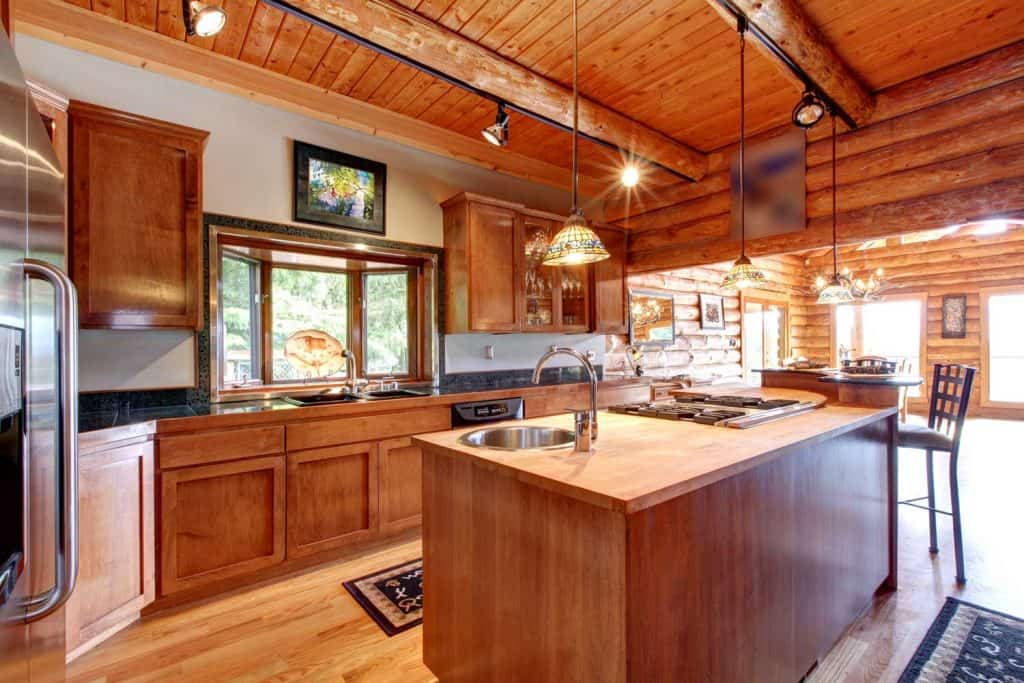 Large kitchen with island in a log cabin
