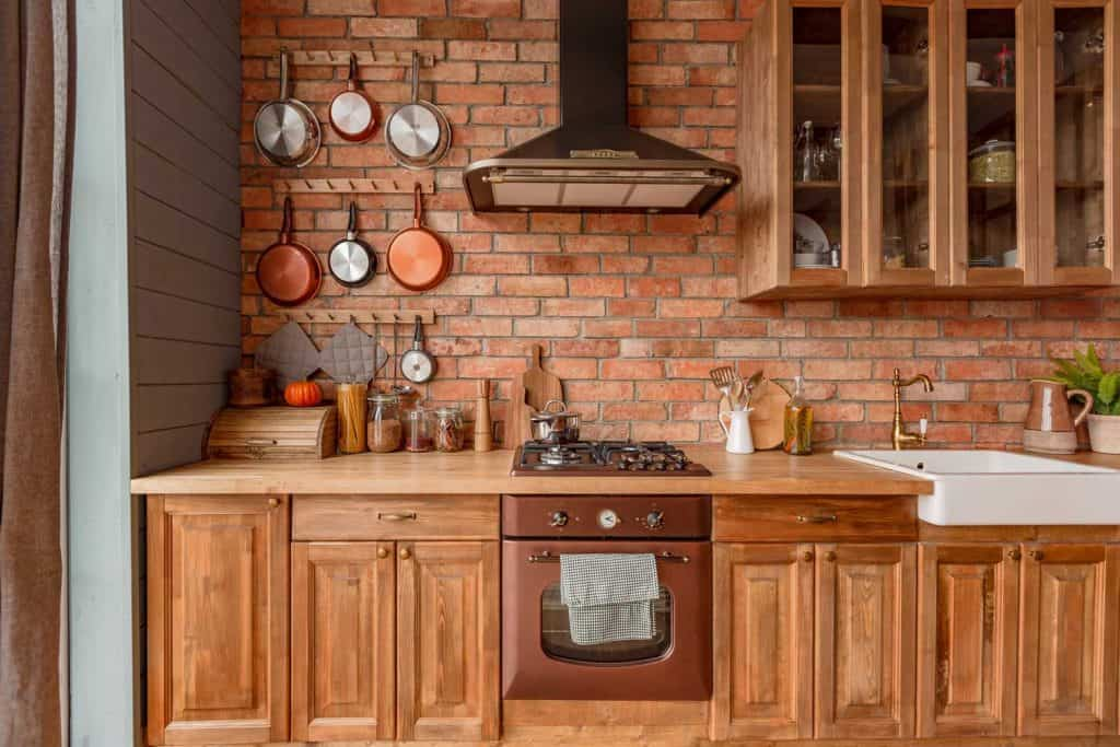 Primitive style kitchen adorned with copper appliances and cooking items