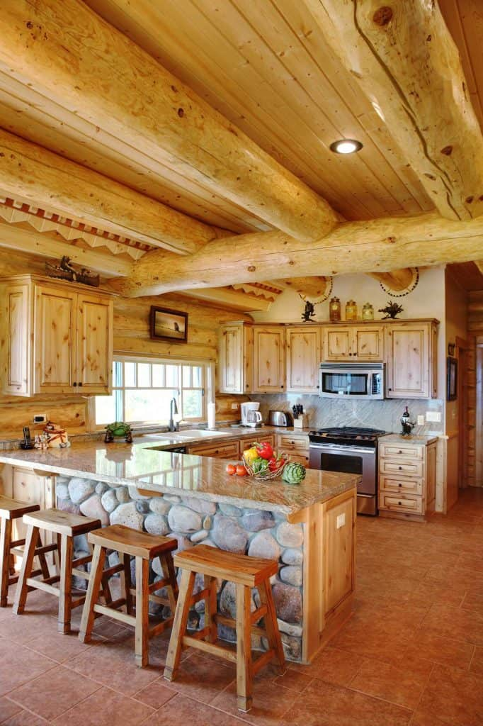 Rustic Kitchen making use of stone and wooden logs for a primitive style feel