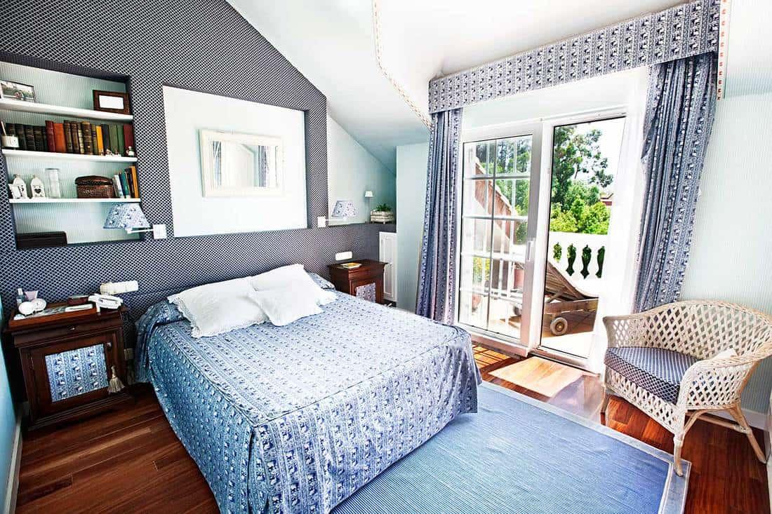 Attic bedroom with parquet flooring and balcony