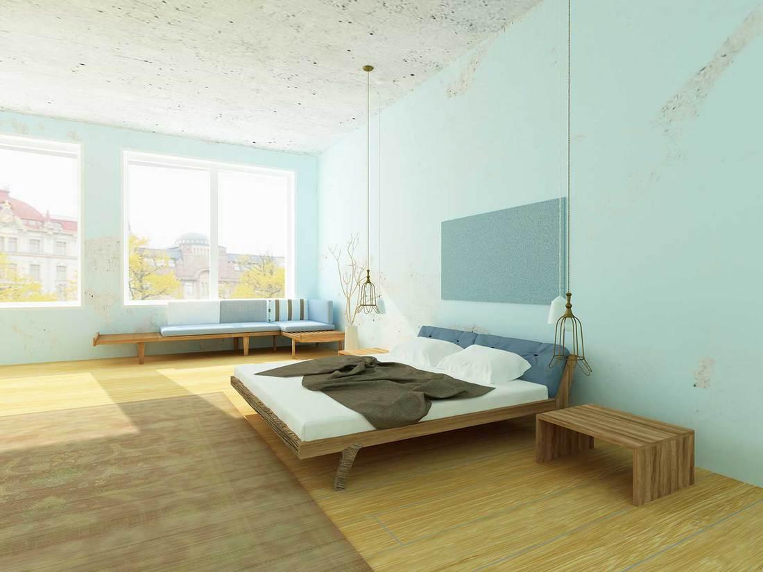 Beautiful cozy bedroom with blue walls, modern chandelier, hardwood floor and vintage carpet