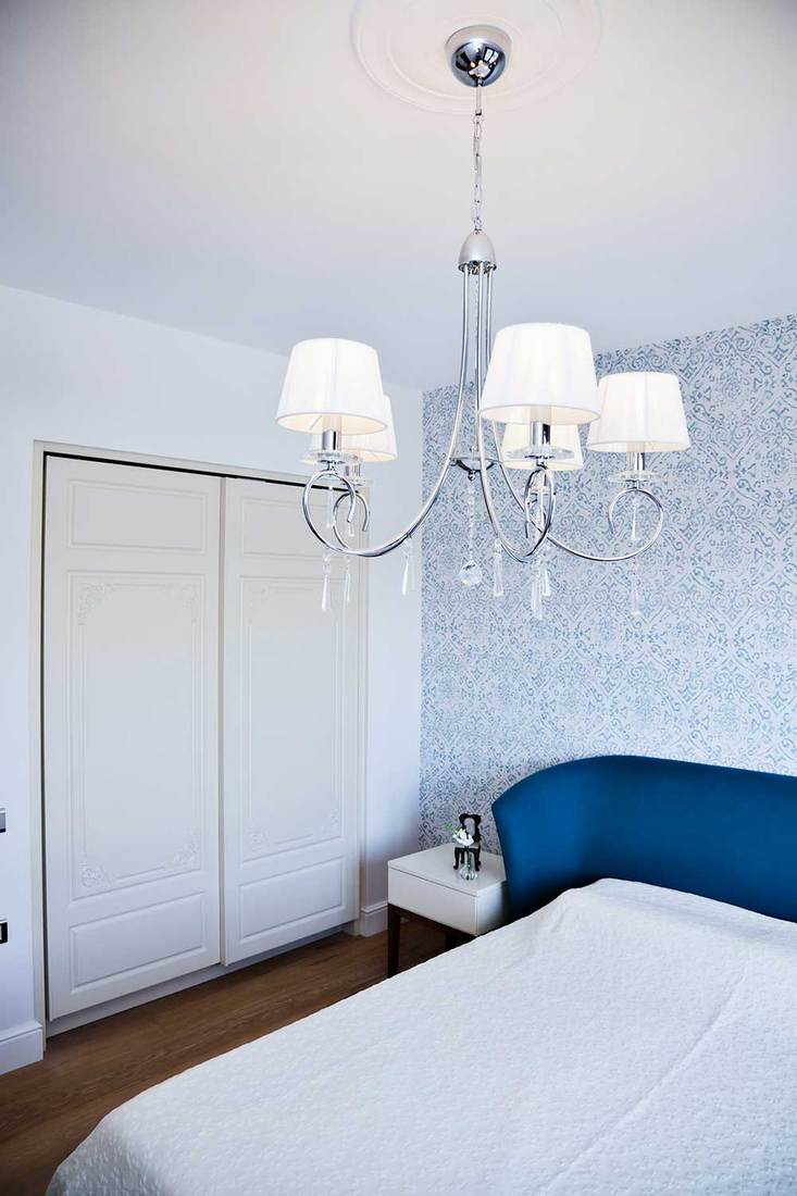 Bedroom with chandelier and wardrobe