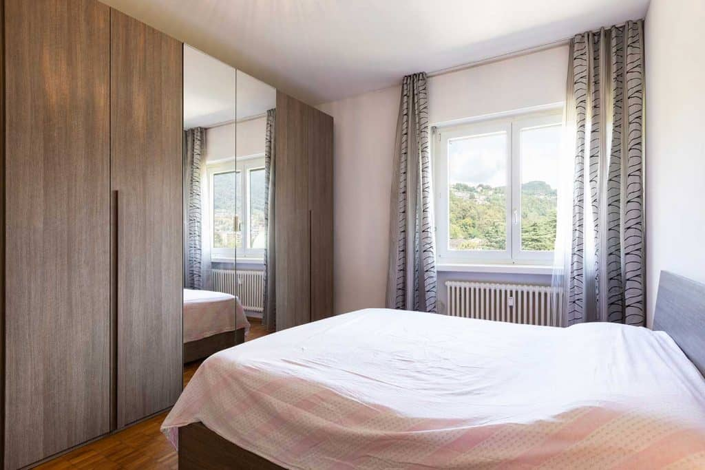 Bedroom with parquet and window with view
