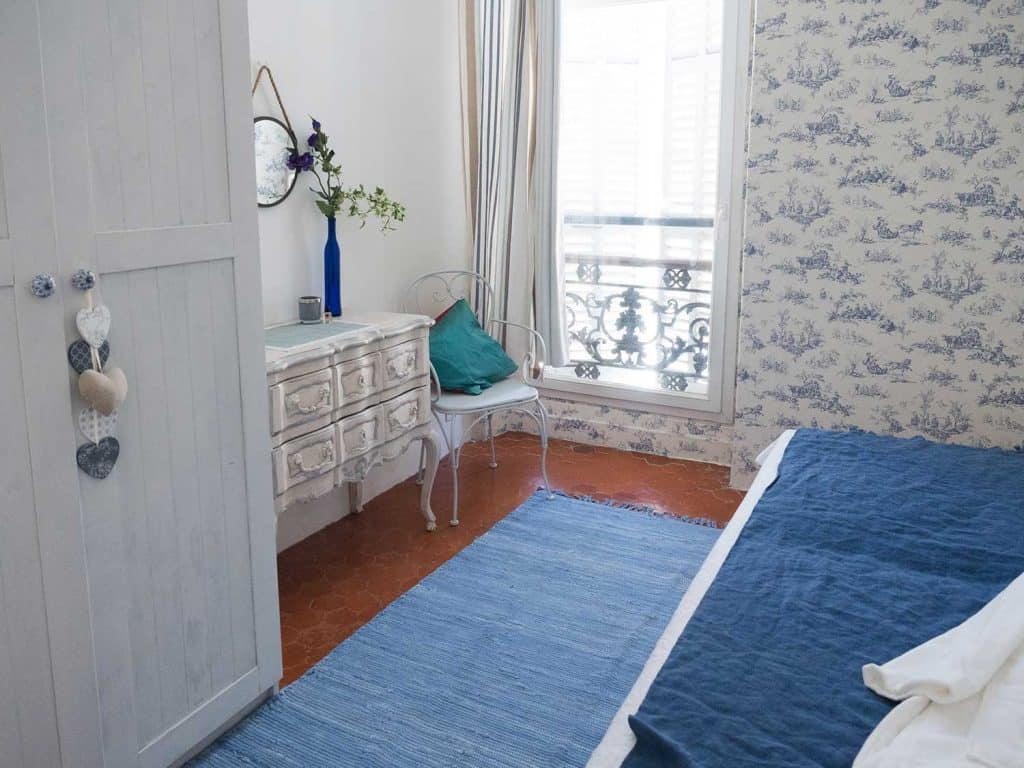 Bedroom with wooden cabinet and window