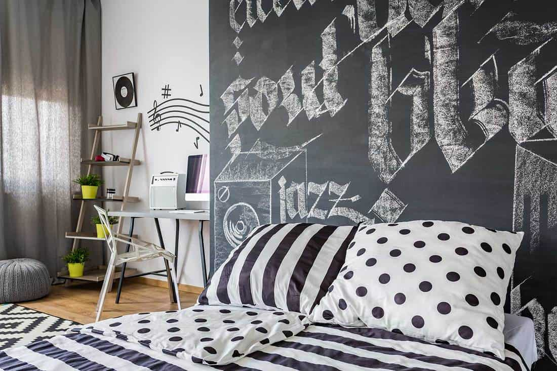 Black and white bedroom with chalk graphite on the wall
