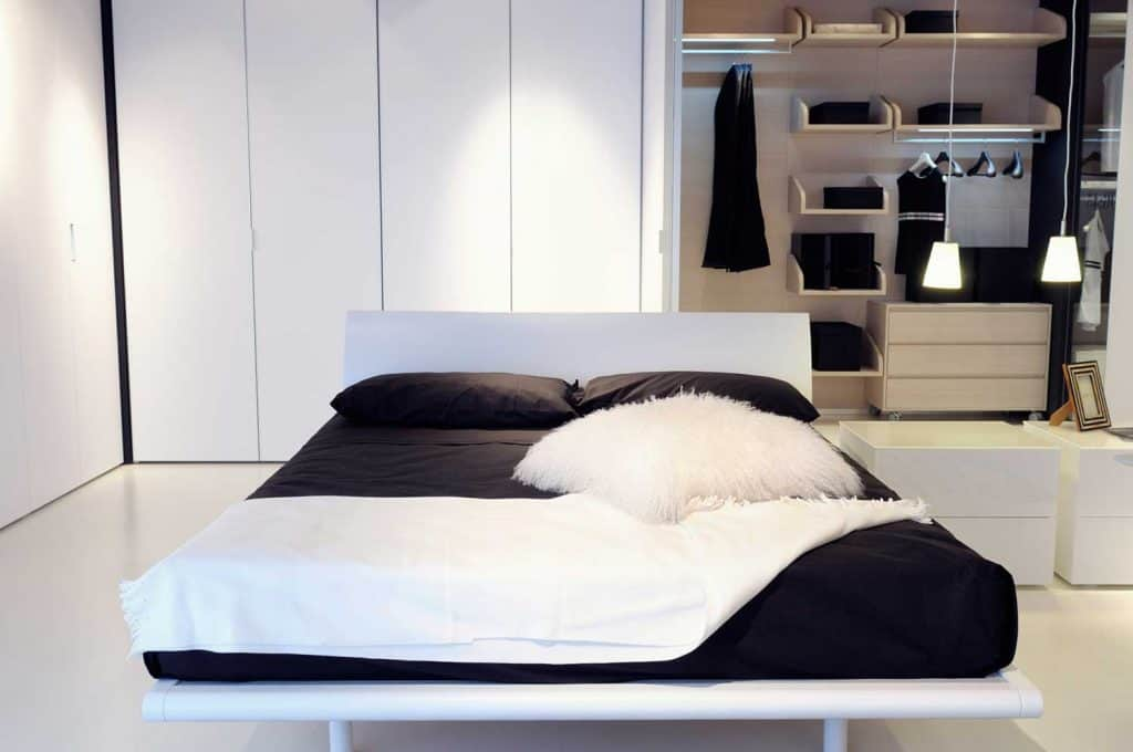 Black and white modern bedroom with wardrobe