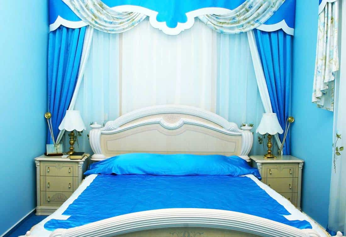 Blue bedroom with luxurious curtains