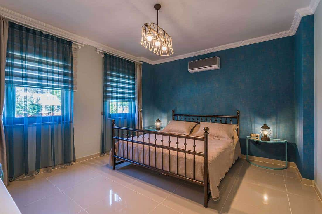 Blue wall bedroom with blue curtain