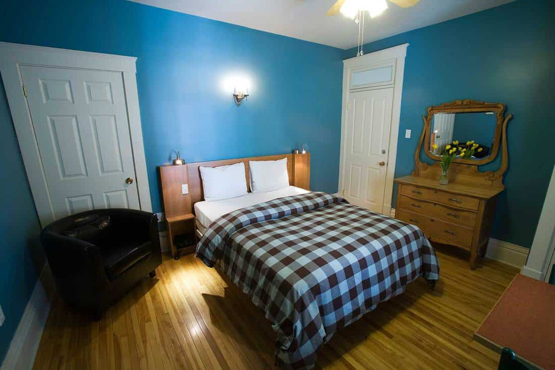 Blue wall bedroom with sofa and wooden interior