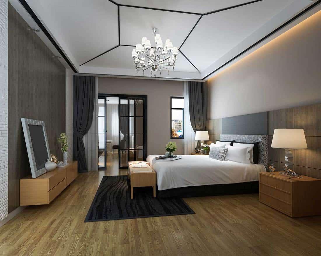 Classy modern bedroom interior with chandelier