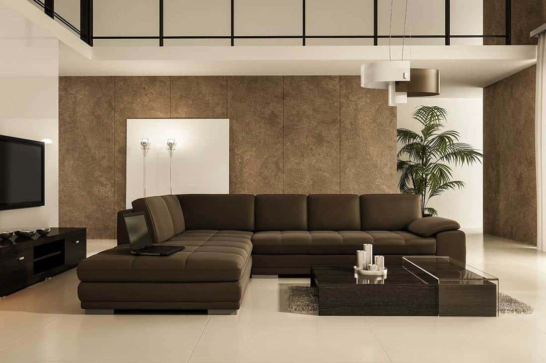 Classy modern living room with laptop on the sofa