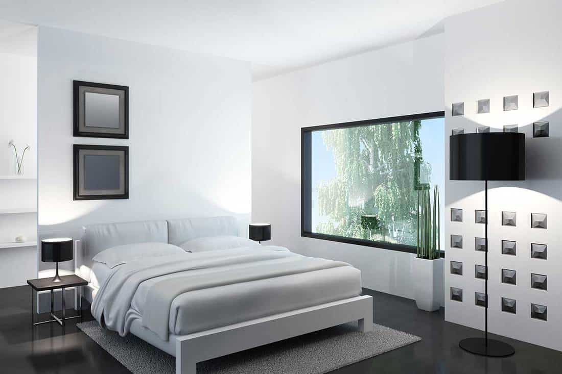 Classy modern white bedroom with huge glass window