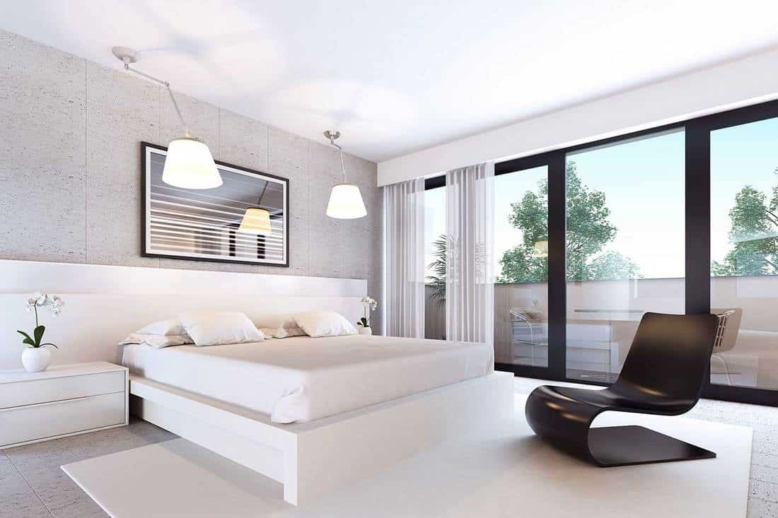 Classy modern white bedroom with pendant lights