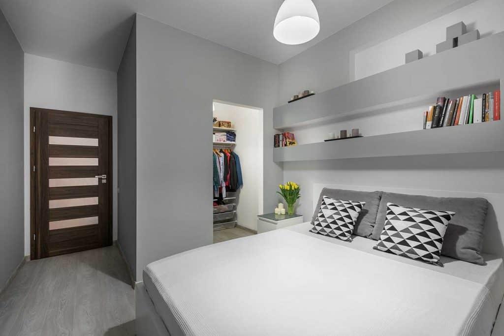 Comfort modern grey bedroom with wardrobe