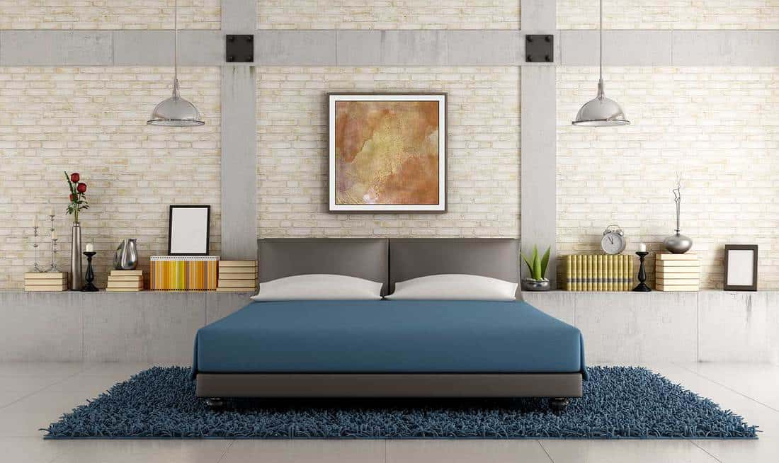 Contemporary bedroom in a loft with brick wall and concrete pillar