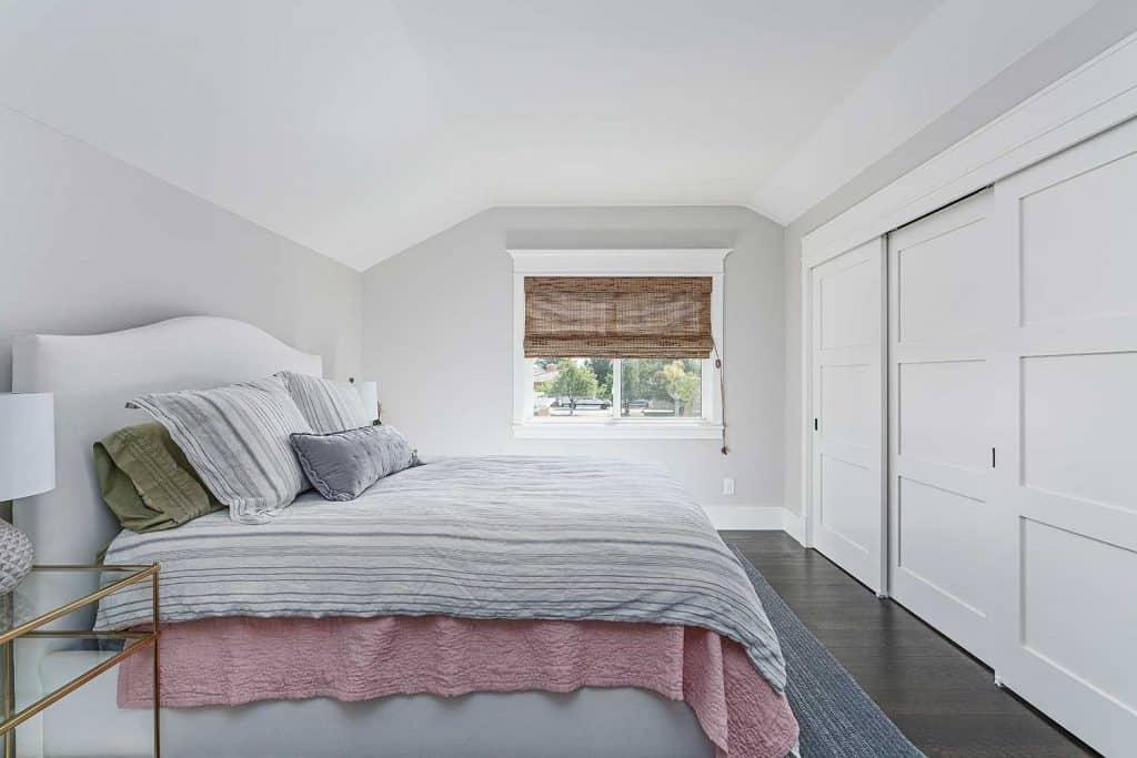 Cozy attic bedroom with wardrobe
