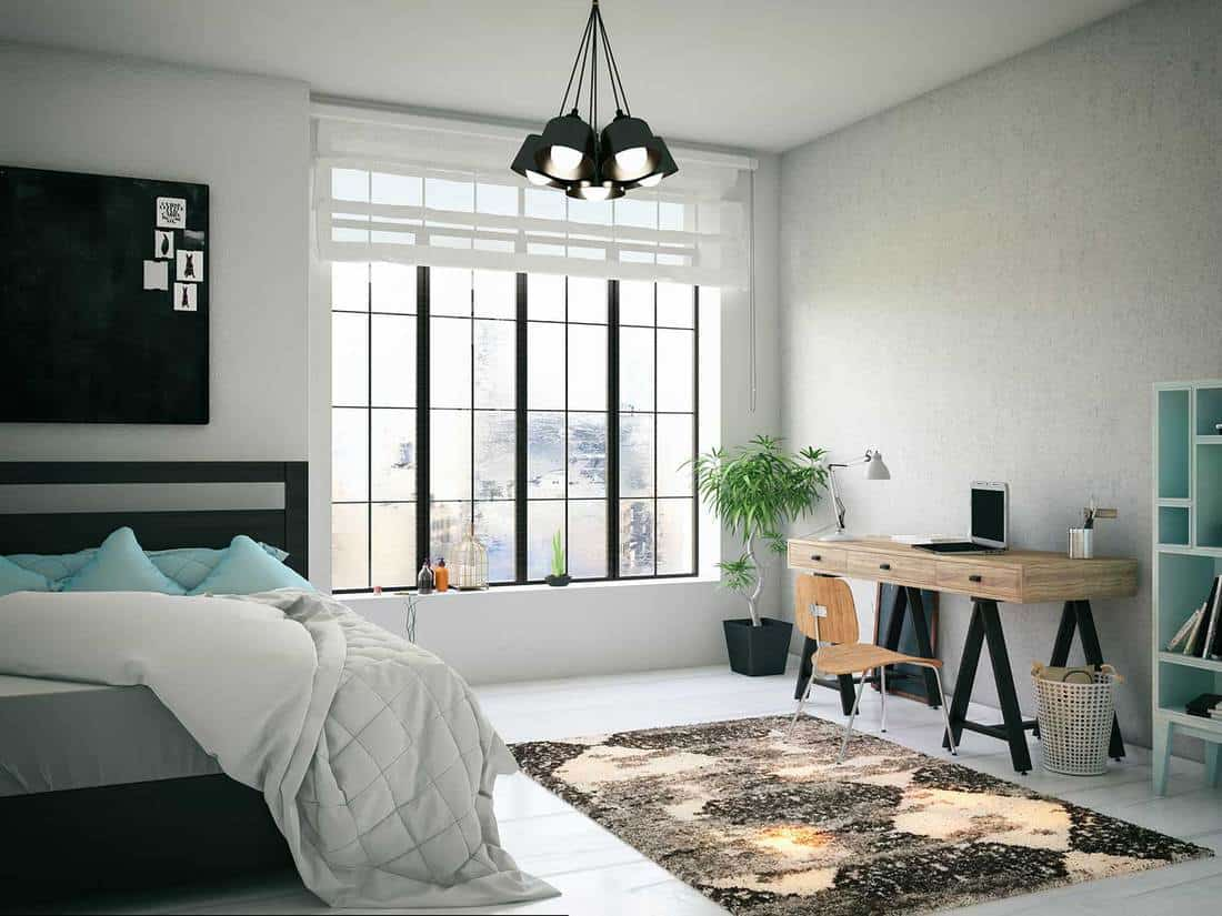 Cozy bedroom with study table and carpet on the floor