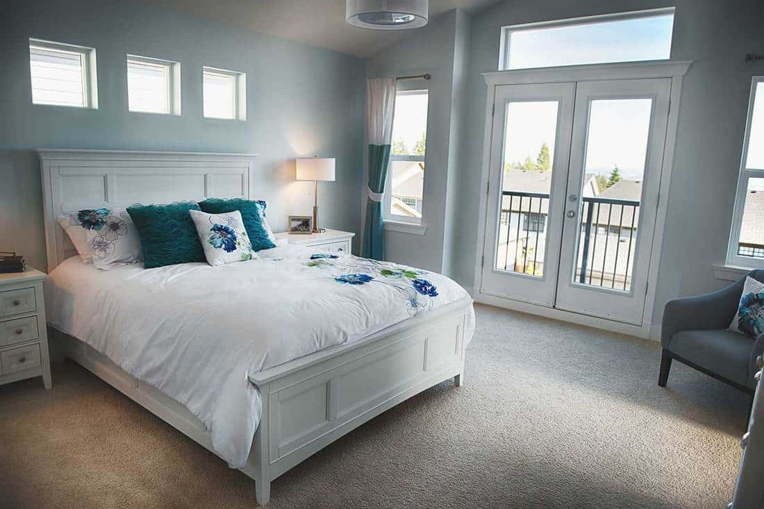 Cozy light modern bedroom with teal blue colors