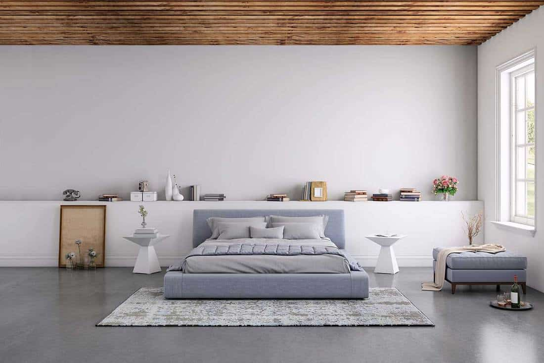 Cozy minimalist bedroom with grey floor and stylish interior