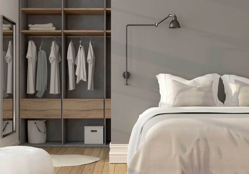 Cozy white bedroom with grey wall and wardrobe
