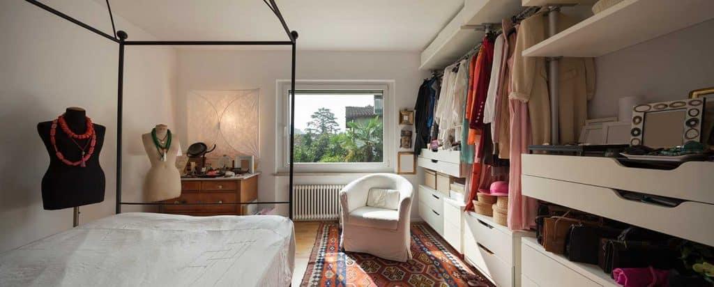 Fashionable bedroom with walk-in wardrobe