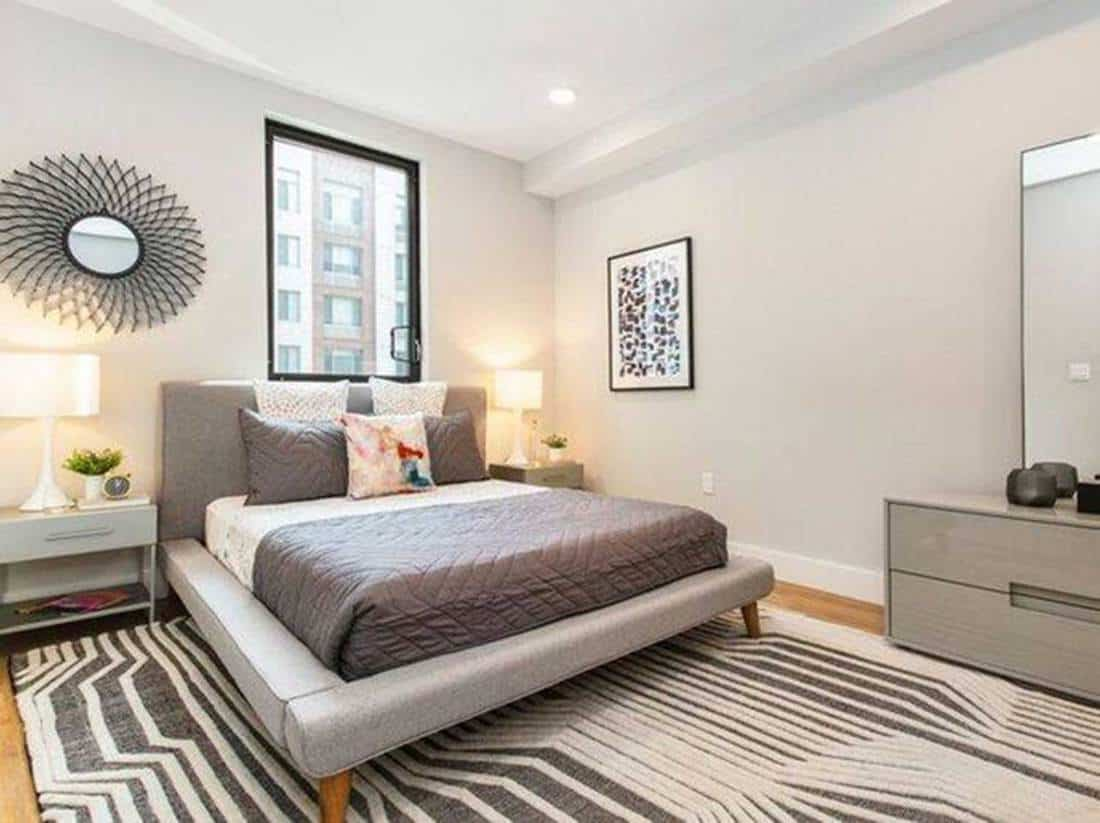 Grey bedroom with abstract design carpet