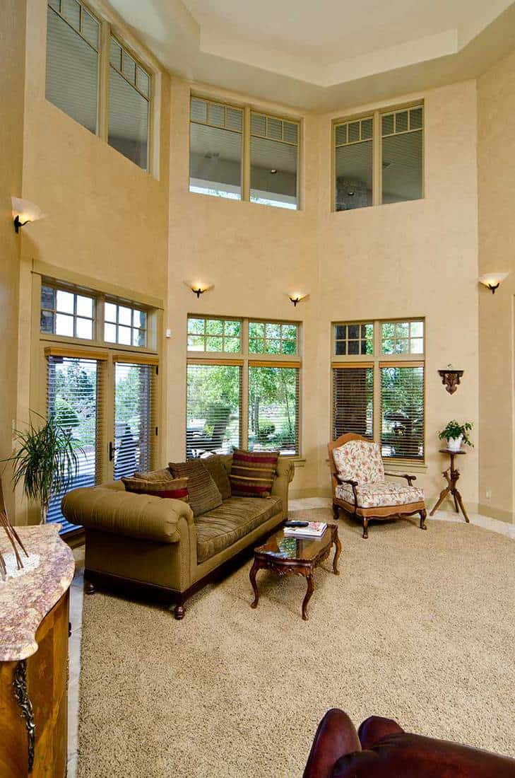 High ceiling living room with carpet floor