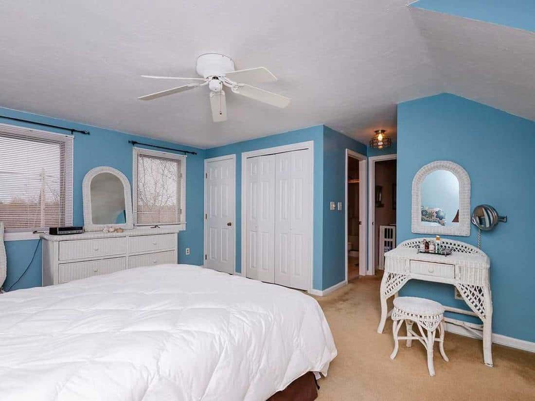 Light blue bedroom with wooden interior