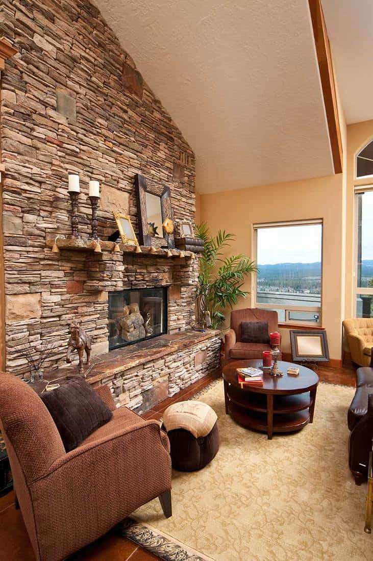 Living room with brick wall fireplace