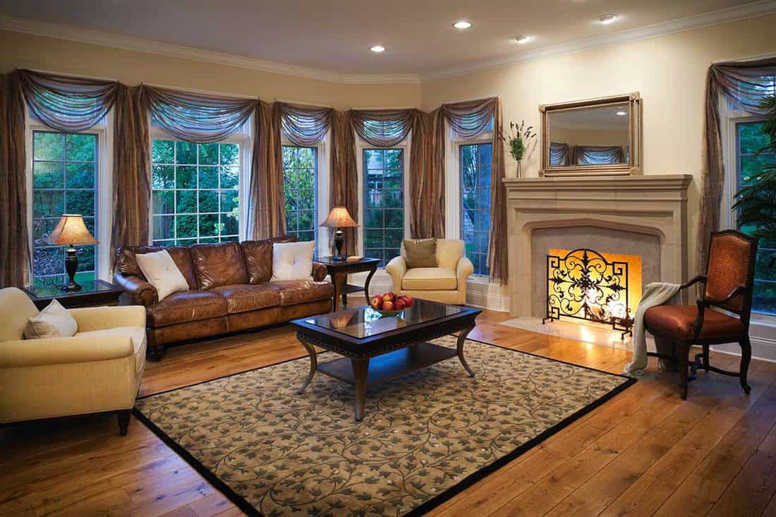 Lovely residential living room with burning fireplace