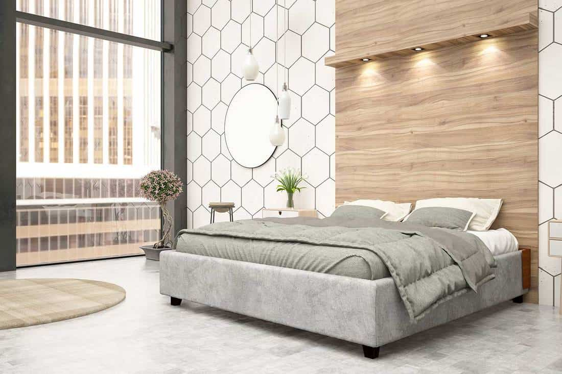 Luxury bedroom with grey bed and house plant interior