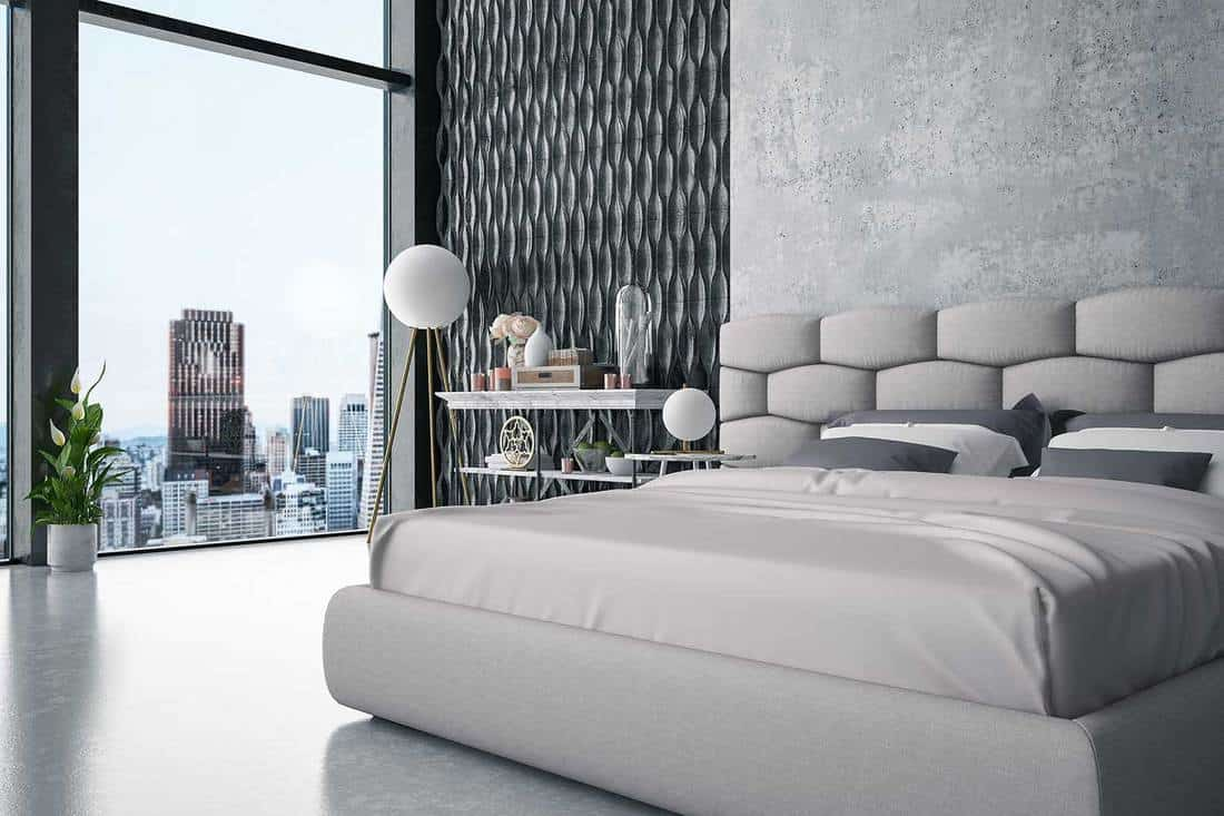Luxury grey themed hotel bedroom with city view