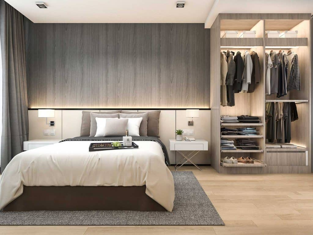 Luxury hotel bedroom with grey carpet and wardrobe
