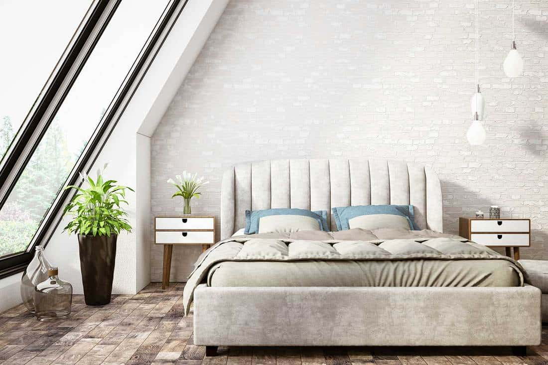 Modern attic bedroom with parquet flooring