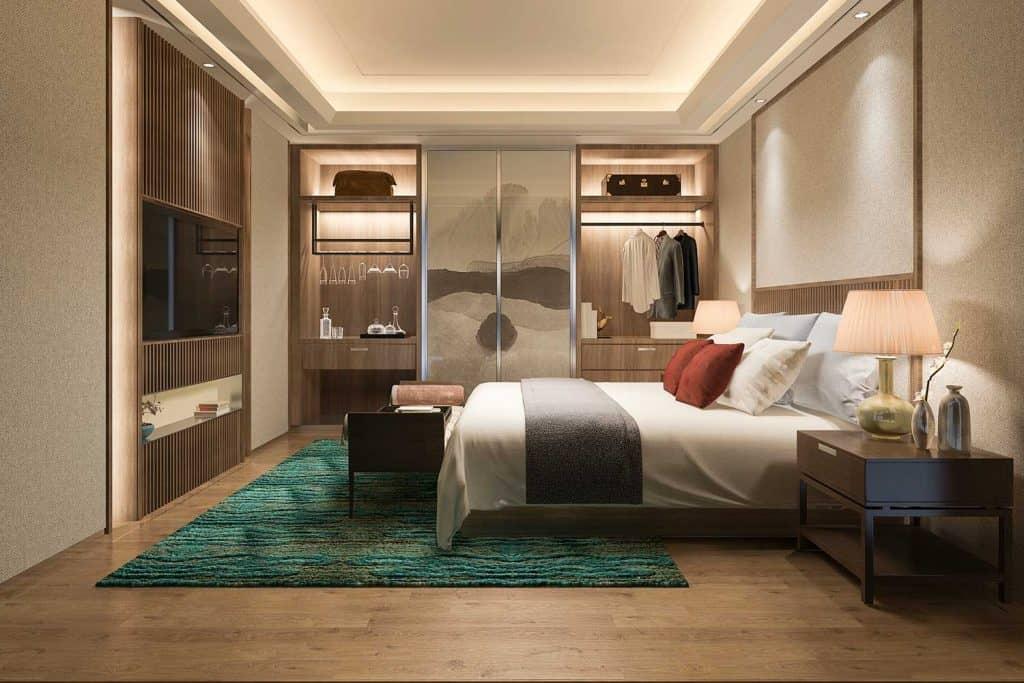Modern bachelor bedroom with dark green carpet
